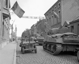 Sherman tanks of 5th Guards Armoured Brigade pass an American jeep in Antoing, Belgium, 3 September 1944. BU 392 Part of WAR OFFICE SECOND WORLD WAR OFFICIAL COLLECTION No 5 Army Film & Photographic Unit Laing (Sgt)